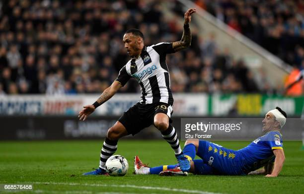 Yoan Gouffran is tackled by Pablo Hernandez of Leeds during the Sky Bet Championship match between Newcastle United and Leeds United at St James'...