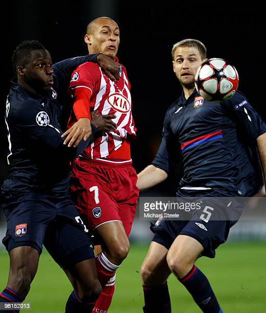 Yoan Gouffran of Bordeaux is sandwiched between Aly Cissokho and Mathieu Bodmer of Lyon during the Lyon v Bordeaux UEFA Champions League quarterfinal...
