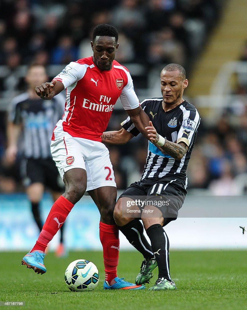Yoan Gouffran (R) of Newcastle challenges Danny Welbeck (L) of Arsenal during the Barclays Premier League match between Newcastle United and Arsenal at St.James' Park on March 21, 2015, in Newcastle upon Tyne, England.