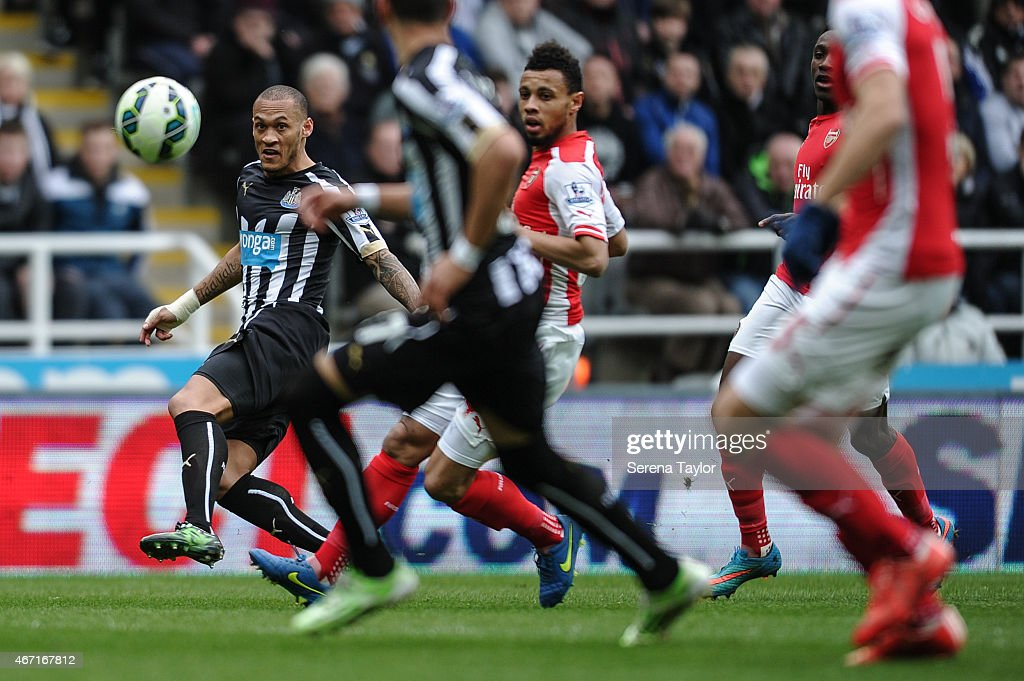 Yoan Gouffran (L) of Newcastle crosses the ball during the Barclays Premier League match between Newcastle United and Arsenal at St.James' Park on March 21, 2015, in Newcastle upon Tyne, England.