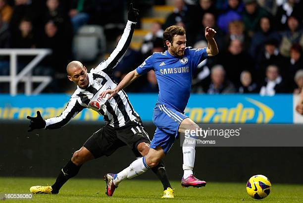 Yoan Gouffran of Newcastle in action with Juan Mata of Chelsea during the Premier League match between Newcastle United and Chelsea at St James Park...