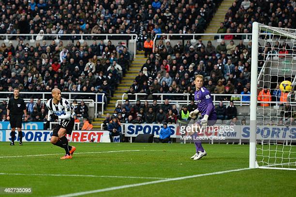 Yoan Gouffran of Newcastle looks back with Joe Hart of City watched by Referee Mike Jones as the shot from Cheick Tiote of Newcastle United hits the...