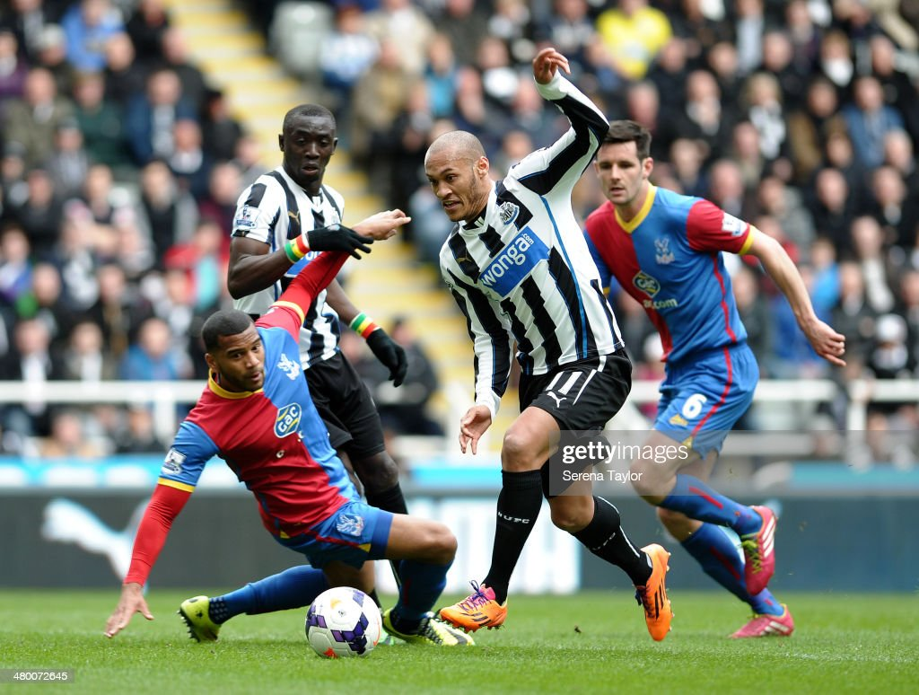 Yoan Gouffran of Newcastle (R) runs past Crystal Palace's Jason Puncheon (L) during the Barclays Premier League match between Newcastle United and Crystal Palace at St. James' Park on March 22, 2014, in Newcastle upon Tyne, England.