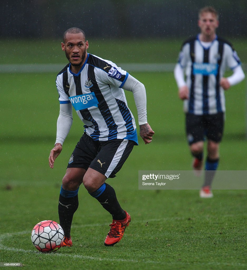 Yoan Gouffran (L) of Newcastle runs with the ball during the U21 Premier League Match between Newcastle United and West Bromwich Albion at Whitley Park on November 23, 2015, in Newcastle upon Tyne, England.
