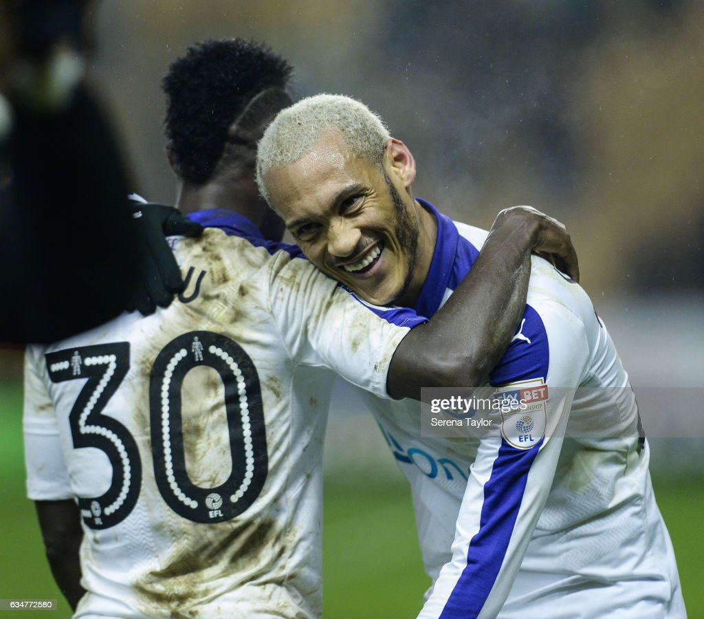 Yoan Gouffran of Newcastle United (R) and Christian Atsu (L) embrace after Newcastle win the Sky Bet Championship mpatch between Wolverhampton Wanderers and Newcastle United at Molineux on February 11, 2017 in North Shields, England.