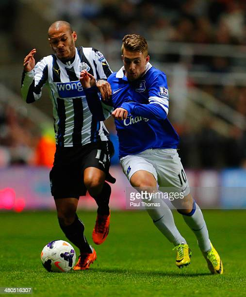 Yoan Gouffran of Newcastle United and Gerard Deulofeu of Everton battle for the ball during the Barclays Premier League match between Newcastle...