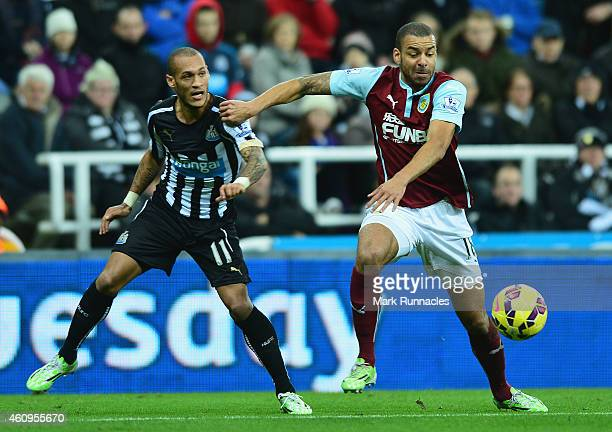 Yoan Gouffran of Newcastle United and Steven Reid of Burnley battle for the ball during the Barclays Premier League match between Newcastle United...