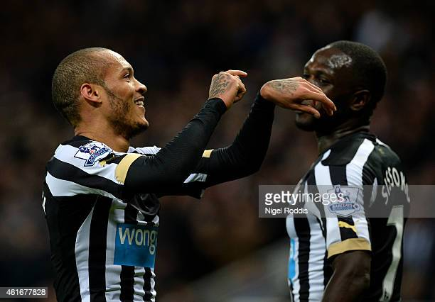 Yoan Gouffran of Newcastle United celebrates after scoring his team's first goal during the Barclays Premier League match between Newcastle United...