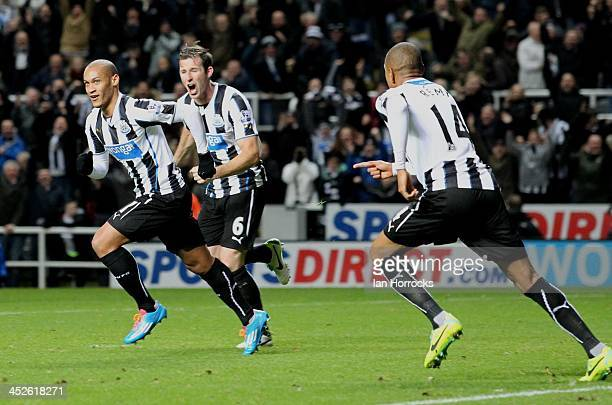 Yoan Gouffran of Newcastle United celebrates scoring the opening goal during the Barclays Premier League match between Newcastle United and West...