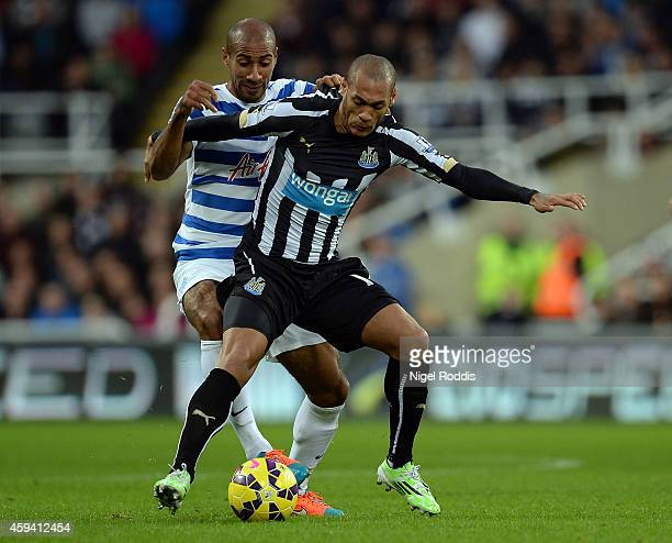 Yoan Gouffran of Newcastle United challenged by Karl Henry of Queeens Park Rangers during the Barclays Premier League football match between...