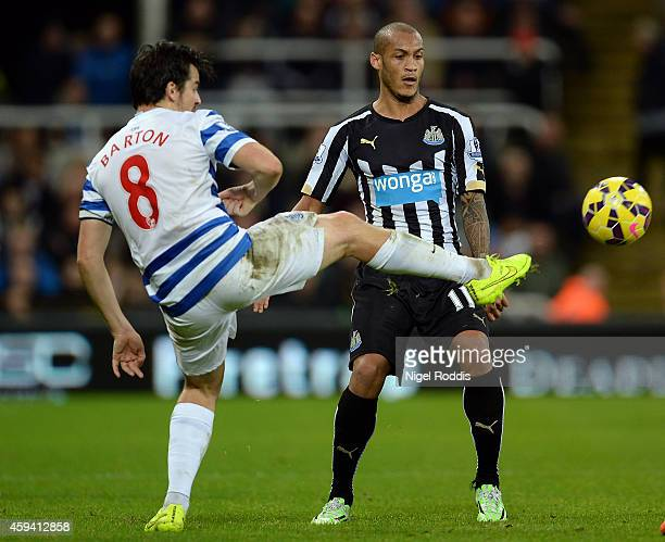 Yoan Gouffran of Newcastle United challenges Joey Barton of Queeens Park Rangers during the Barclays Premier League football match between Newcastle...