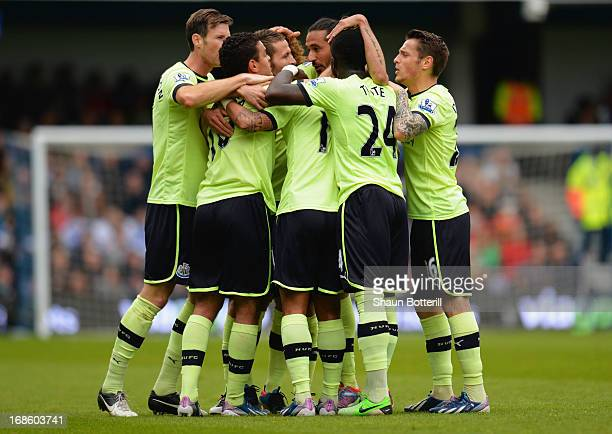 Yoan Gouffran of Newcastle United is congratulated by team mates as he scores their second goal during the Barclays Premier League match between...
