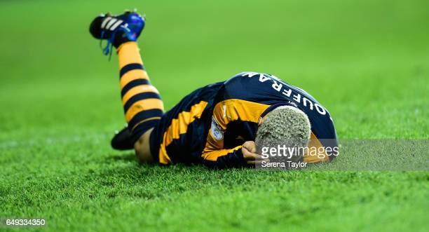 Yoan Gouffran of Newcastle United lays on the ground with an injury to his eye during the Sky Bet Championship Match between Reading and Newcastle...