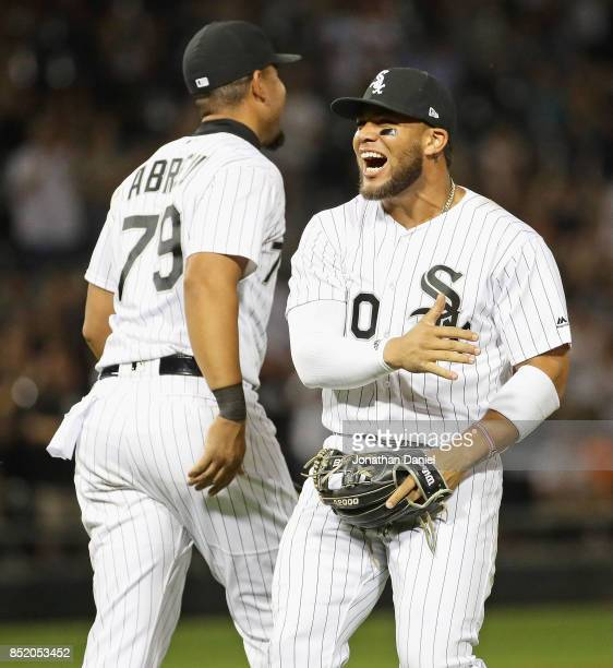 Yoan Moncada and Jose Abreu of the Chicago White Sox celebrate a win over the Kansas City Royals at Guaranteed Rate Field on September 22 2017 in...