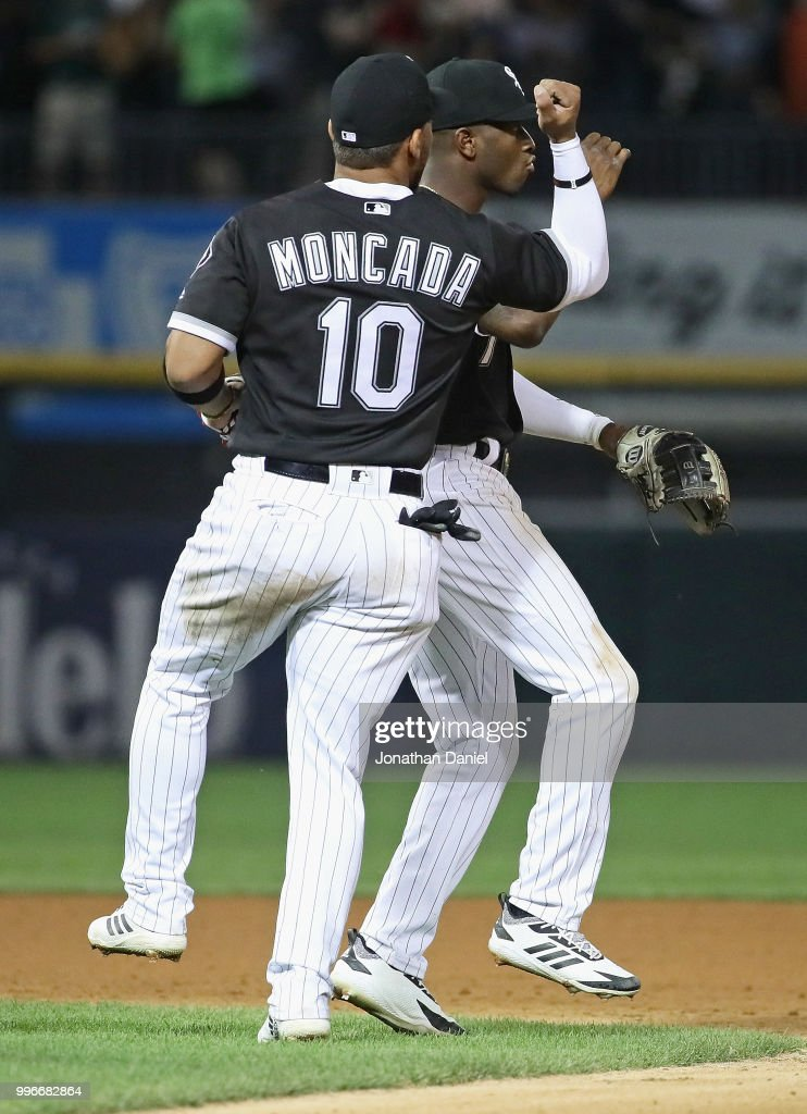 Yoan Moncada #10 and Tim Anderson #7 of the Chicago White Sox celebrate a win over the St. Louis Cardinals at Guaranteed Rate Field on July 11, 2018 in Chicago, Illinois. The White Sox defeated the Cardinals 4-0.
