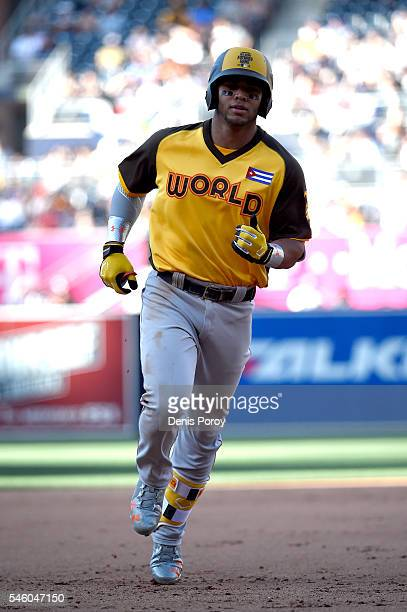 Yoan Moncada of the Boston Red Sox and the World Team hits a a home run during the SiriusXM AllStar Futures Game at PETCO Park on July 10 2016 in San...