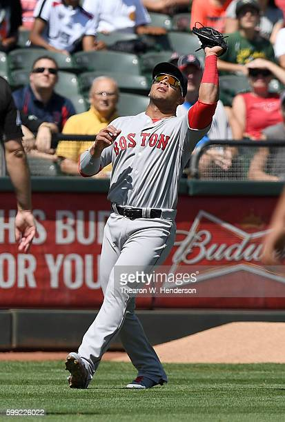 Yoan Moncada of the Boston Red Sox catches a foul popup off the bat of Stephen Vogt of the Oakland Athletics in the bottom of the second inning at...