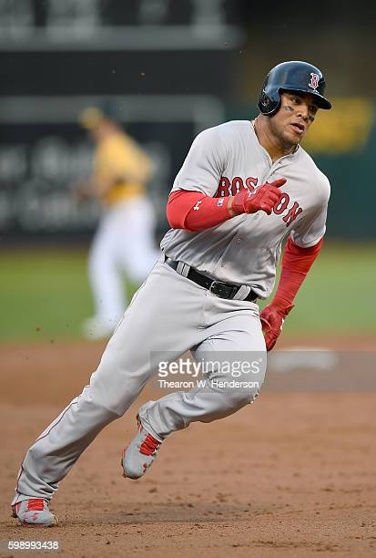 Yoan Moncada of the Boston Red Sox rounds third base to score on an rbi single from Jackie Bradley Jr #25 against the Oakland Athletics in the top of...