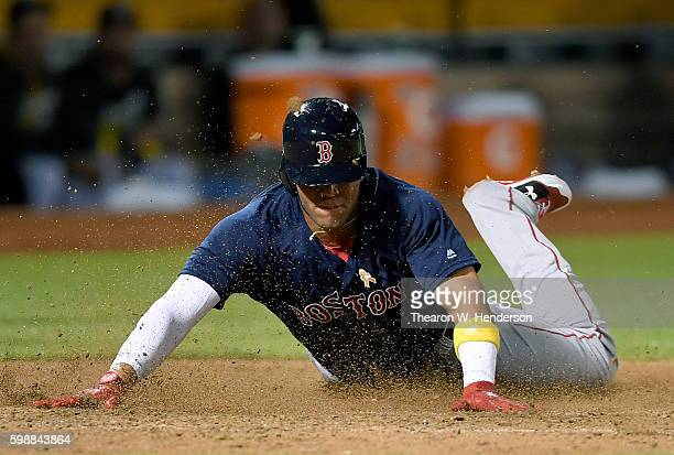 Yoan Moncada of the Boston Red Sox scores on an rbi double from Travis Shaw against the Oakland Athletics in the top of the eighth inning at...