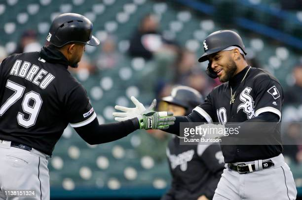 Yoan Moncada of the Chicago White Sox celebrates his solo home run against the Detroit Tigers with Jose Abreu of the Chicago White Sox during the...