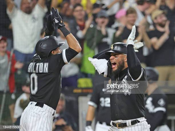 Yoan Moncada of the Chicago White Sox celebrates his two run home run in the 8th inning with pinch runner Billy Hamilton against the Detroit Tigers...