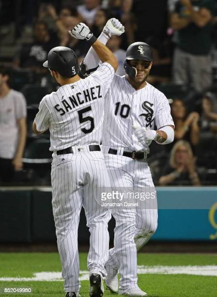Yoan Moncada of the Chicago White Sox celebrates his two run home run in the 4th inning against the Kansas City Royals with teammate Yolmer Sancjez...