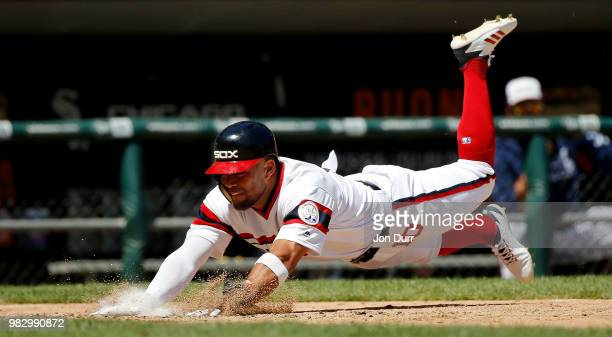 Yoan Moncada of the Chicago White Sox dives to score on an RBI single hit by Avisail Garcia against the Oakland Athletics during the sixth inning...