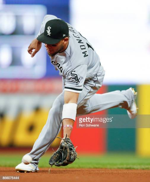 Yoan Moncada of the Chicago White Sox fields the ball and throws out Lonnie Chisenhall of the Cleveland Indians at first base during the second...