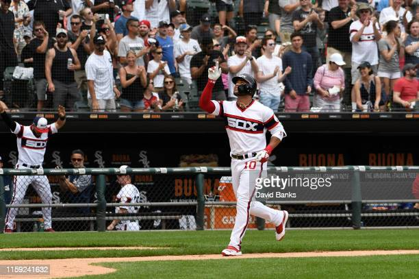 Yoan Moncada of the Chicago White Sox gestures as runs the bases after hitting a two run home run against the Minnesota Twins during the third inning...