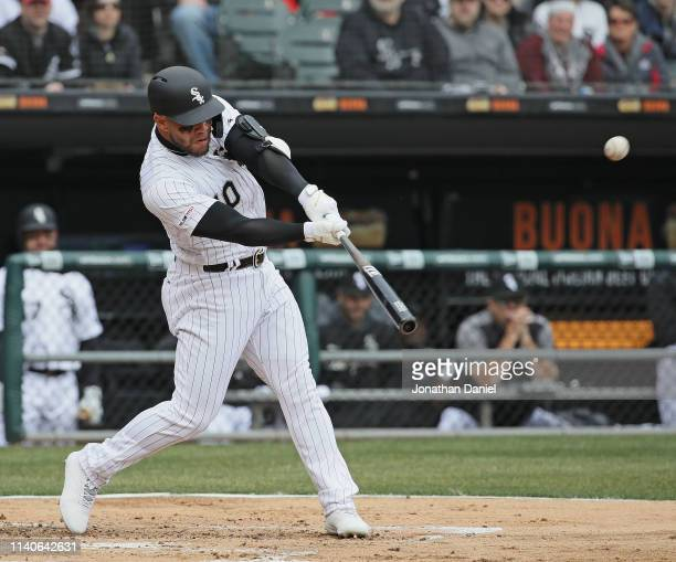 Yoan Moncada of the Chicago White Sox hits a two run double in the 1st inning against the Seattle Mariners during the season home opening game at...