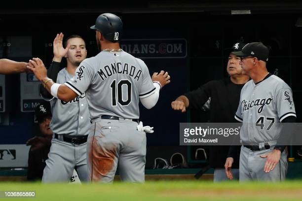 Yoan Moncada of the Chicago White Sox is congratulated as he returns to the dugout after scoring on a single by Avisail Garcia in the first inning...