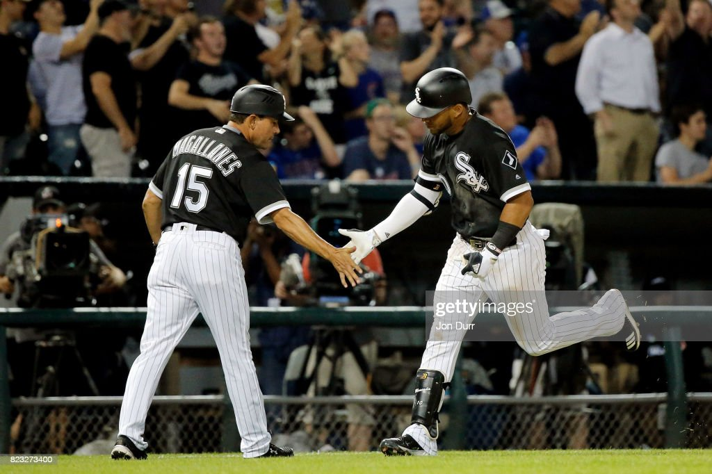 Yoan Moncada #10 of the Chicago White Sox is congratulated by third base coach Ever Margallanes #15 after hitting his first career home run, against the Chicago Cubs, during the seventh inning at Guaranteed Rate Field on July 26, 2017 in Chicago, Illinois.