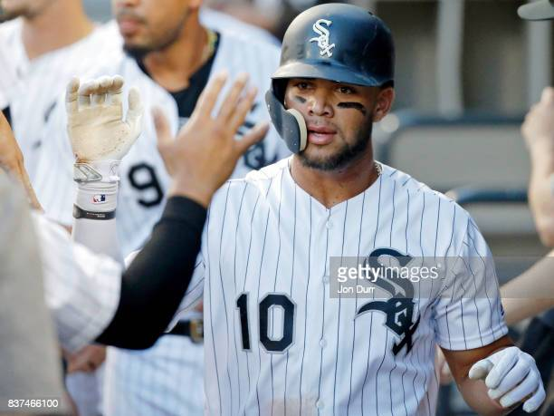 Yoan Moncada of the Chicago White Sox is congratulated in the dugout after scoring on a wild pitch against the Minnesota Twins at Guaranteed Rate...
