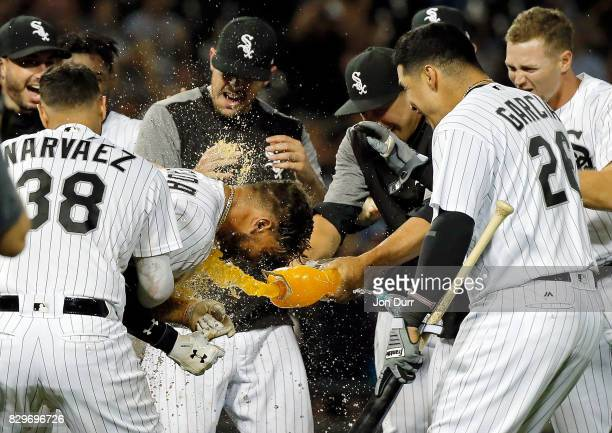 Yoan Moncada of the Chicago White Sox is mobbed by teammates after hitting a walkoff RBI single against the Houston Astros at Guaranteed Rate Field...