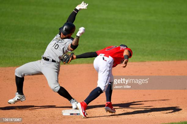 Yoan Moncada of the Chicago White Sox is safe at second as second baseman Cesar Hernandez of the Cleveland Indians tries to make the tag during the...