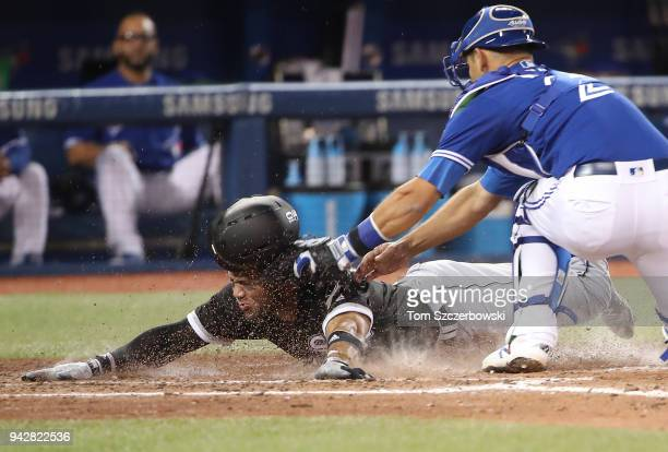 Yoan Moncada of the Chicago White Sox is tagged out at home plate by Luke Maile of the Toronto Blue Jays in the seventh inning during MLB game action...