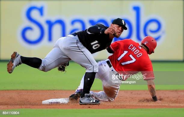 Yoan Moncada of the Chicago White Sox makes the tag for the out against ShinSoo Choo of the Texas Rangers in the bottom of the first inning at Globe...
