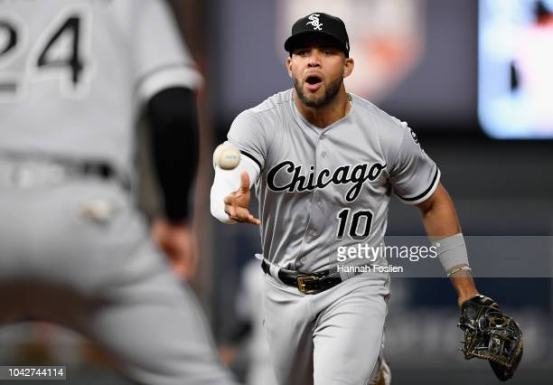 Yoan Moncada of the Chicago White Sox passes the ball to teammate Matt Davidson to get out Max Kepler of the Minnesota Twins at first base during the...