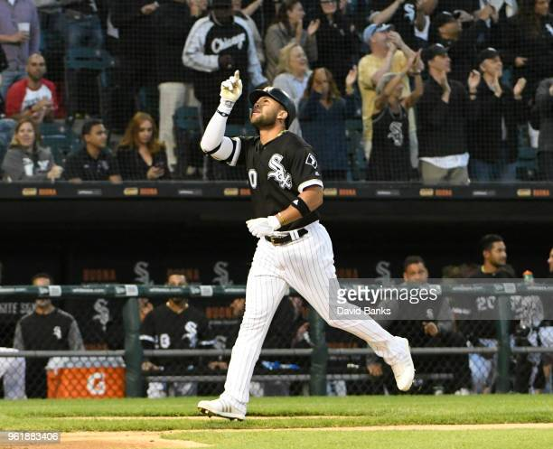 Yoan Moncada of the Chicago White Sox reacts as he runs the bases after hitting a threerun homer against the Baltimore Orioles during the third...