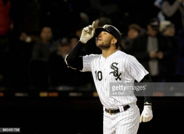 Yoan Moncada of the Chicago White Sox reacts by pointing to the sky after hitting a home run against the Seattle Mariners during the fourth inning at...