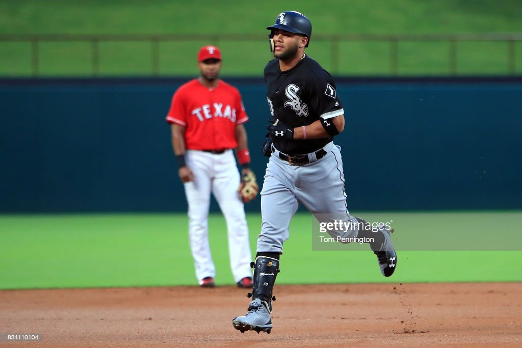 Yoan Moncada #10 of the Chicago White Sox rounds the bases after hitting a solo home run against the Texas Rangers in the top of the first inning at Globe Life Park in Arlington on August 17, 2017 in Arlington, Texas.