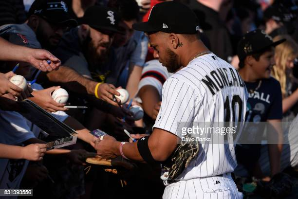 Yoan Moncada of the Chicago White Sox signs autographs before the game against the Kansas City Royals on August 12 2017 at Guaranteed Rate Field in...