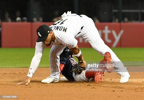 Yoan Moncada of the Chicago White Sox tags out Mookie Betts of the Boston Red Sox at second base during the first inning on August 31 2018 at...
