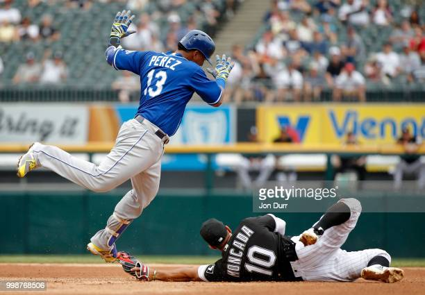 Yoan Moncada of the Chicago White Sox tags out Salvador Perez of the Kansas City Royals at second base during the fourth inning at Guaranteed Rate...