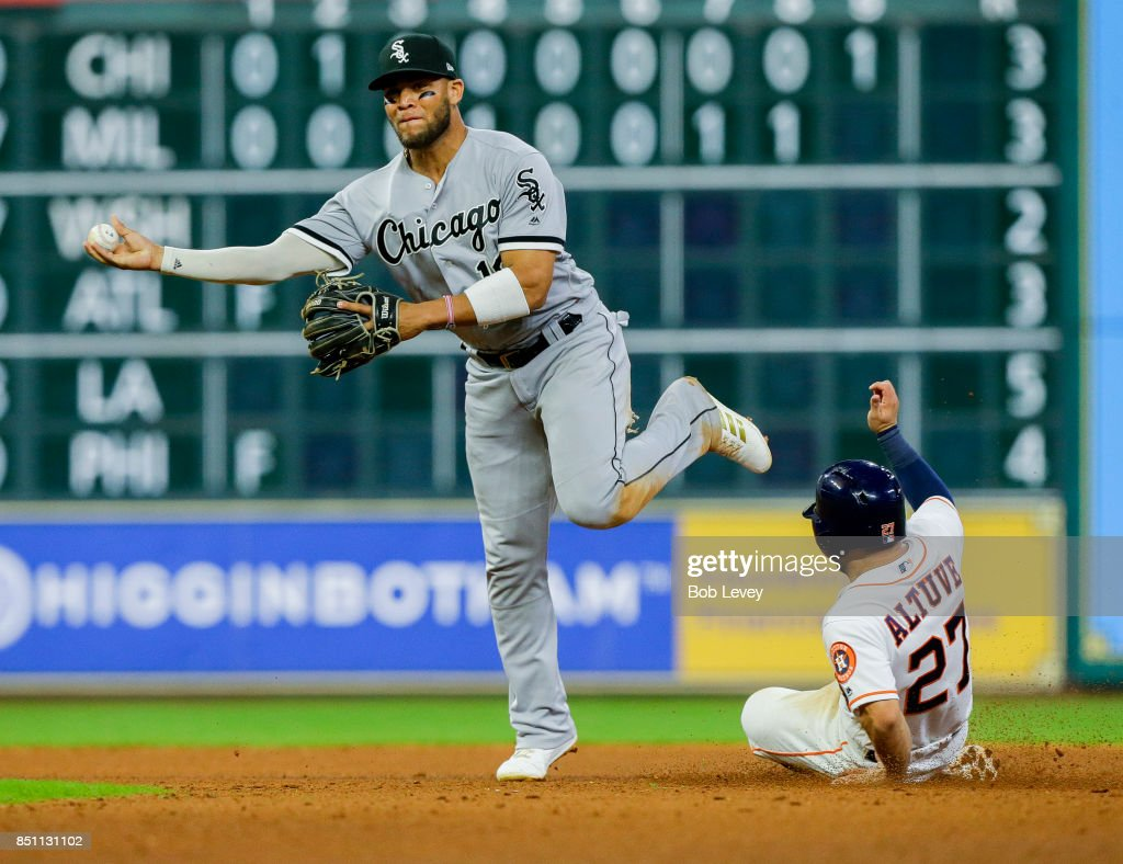 Yoan Moncada #10 of the Chicago White Sox throw over a sliding Jose Altuve #27 of the Houston Astros in the ninth inning at Minute Maid Park on September 21, 2017 in Houston, Texas.