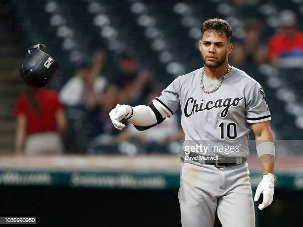 Yoan Moncada of the Chicago White Sox throws his batting helmet after striking out against the Cleveland Indians in the tenth inning at Progressive...