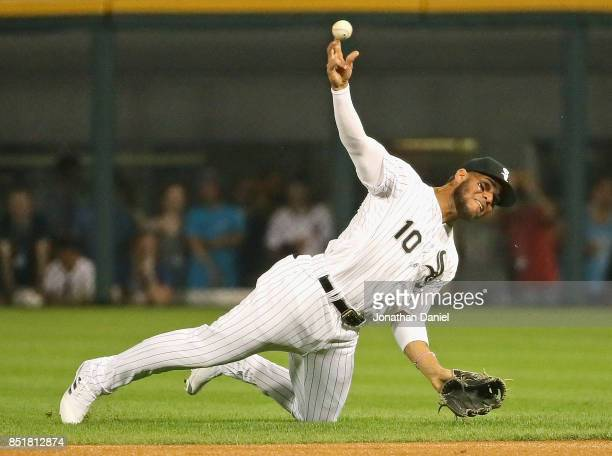 Yoan Moncada of the Chicago White Sox throws out a Kansas City Royals runner from his knee in the 1st inning at Guaranteed Rate Field on September 22...