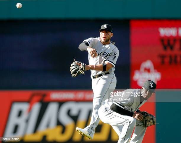 Yoan Moncada of the Chicago White Sox throws to first base as Tim Anderson ducks out of the way in the sixth inning at Progressive Field on October 1...