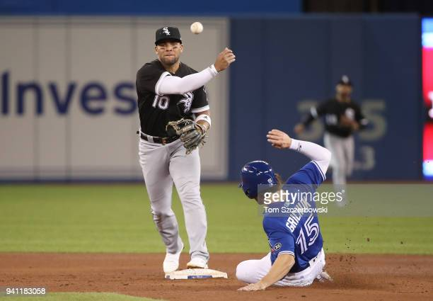 Yoan Moncada of the Chicago White Sox turns a double play to end the fifth inning during MLB game action as Randal Grichuk of the Toronto Blue Jays...