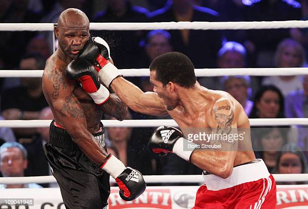 Yoan Pablo Hernandez of Cuba punches Steve Herelius of France during the WBA Cruiserweight Title Fight between Yoan Pablo Hernandez of Cuba and Steve...